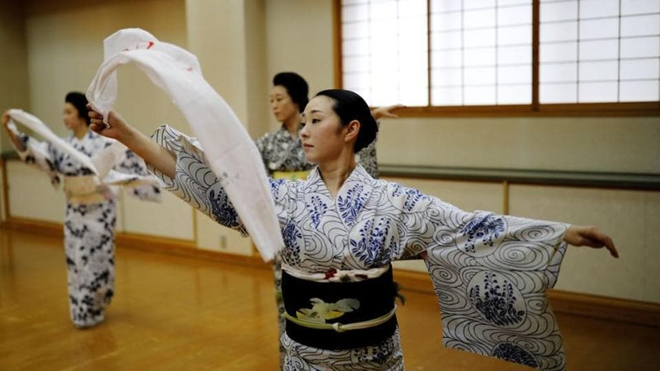 (L-R) Mayu, Maki and Koiku practice a dance routine during a class only for geisha in Tokyo on July 13. Coronavirus-induced austerity has slashed expense accounts, and many people remain wary of spending hours in the elegant but closed traditional rooms where geisha entertain. (Kim Kyung-Hoon / REUTERS)