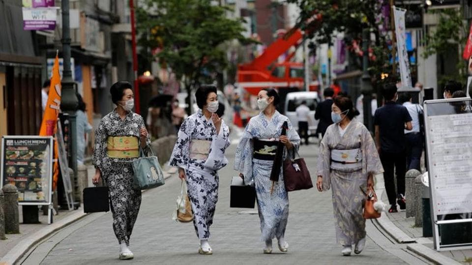 Geisha are seen wearing face masks as they stroll at a street in Tokyo after their dance class on July 13. Though the ancient capital of Kyoto is best known for geisha, Tokyo has six geisha districts of its own. But discouraged by the rigour of geisha life with its hours of artistic practice, very few now join. (Kim Kyung-Hoon / REUTERS)