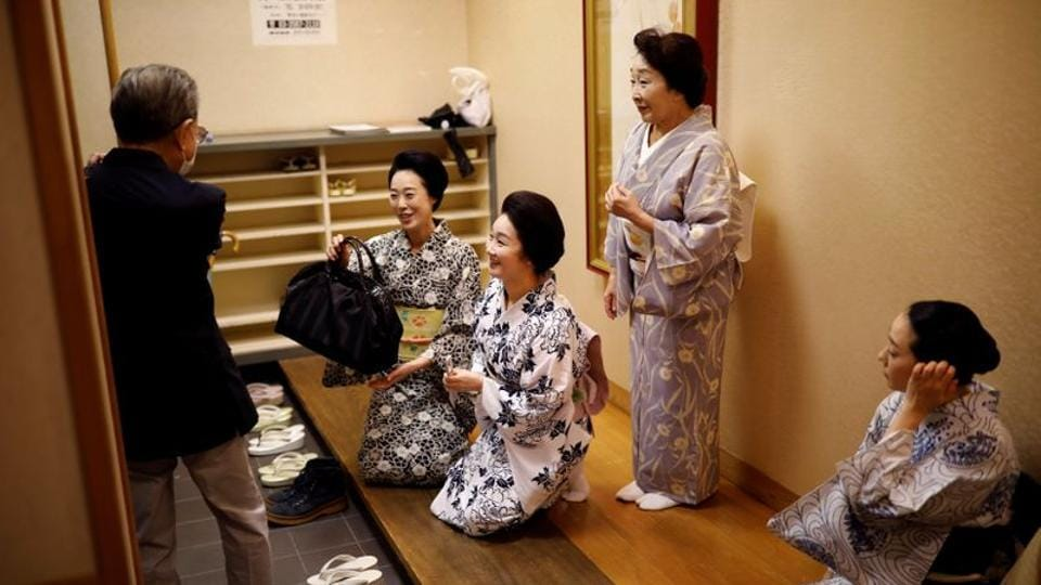 (2nd L-R) Maki, Mayu, Ikuko and Koiku greet Fujima Hideka, a dance master of Japanese traditional dance, after attending a dance class for geisha in Tokyo on July 13. Lessons and kimono are expensive, with pay dependent on popularity. And some skills, such as the witty conversation that make older geisha like Ikuko especially popular, can only be gained through time. (Kim Kyung-Hoon / REUTERS)
