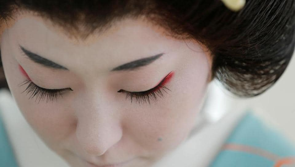 Koiku, who is a geisha, gets ready at Ikuko's home to work at a party being hosted by customers at a luxury restaurant, where she will be entertaining with other geisha, during the coronavirus (COVID-19) outbreak, in Tokyo, Japan, June 23, 2020.