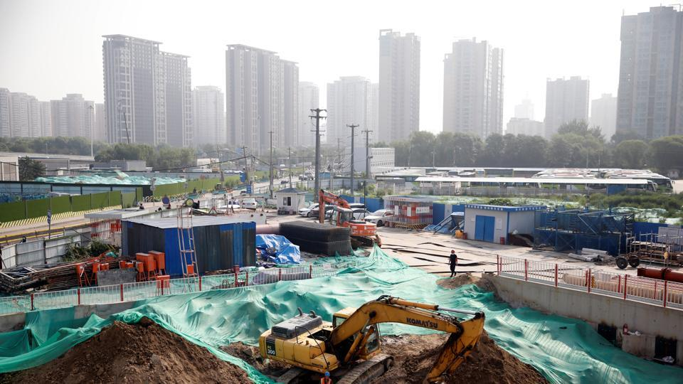 Workers work at a construction site in Beijing, China.