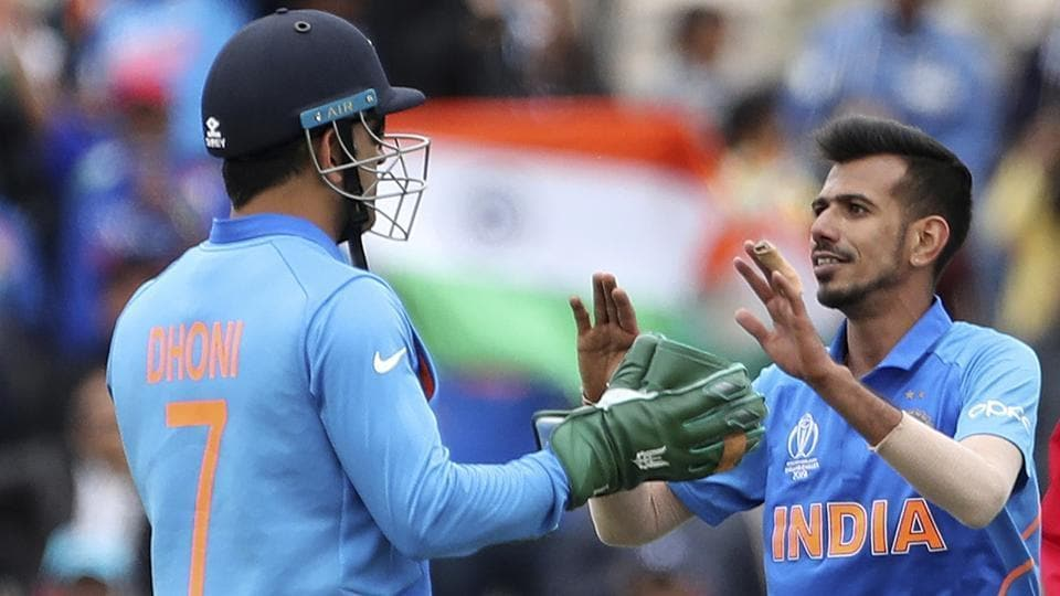 India's Yuzvendra Chahal, right, celebrates with teammate MS Dhoni the dismissal of South Africa's Andile Phehlukwayo during the Cricket World Cup match between South Africa and India .