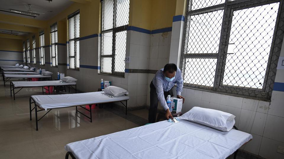 A worker sets up beds in a Covid-19 isolation facility at Balak Ram Hospital in New Delhi on July 16. India took 137 days to log a million cases, and half of these were recorded during a hard nationwide lockdown announced on March 24. Officials and experts said that the lockdown bought the country time to set up isolation centres, add hospital beds and beef up testing infrastructure. (Biplov Bhuyan / HT Photo)