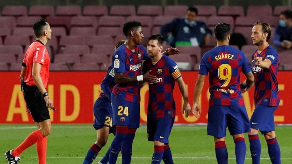 Barcelona's Lionel Messi celebrates scoring their first goal with teammates, as play resumes behind closed doors following the outbreak of the coronavirus disease (COVID-19) REUTERS/Albert Gea
