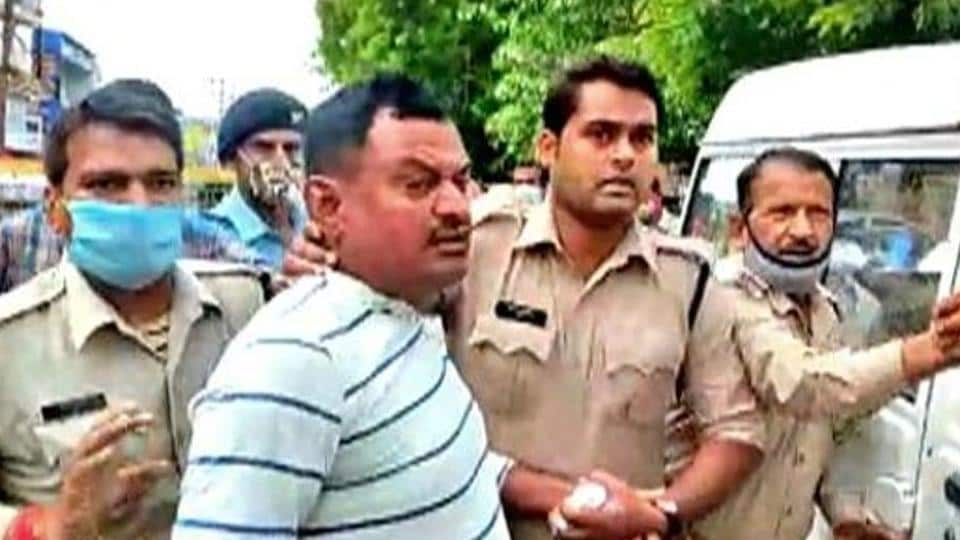 Police personnel were bringing Vikas Dubey back from Ujjain, where he was arrested while on the run from the UPpolice.