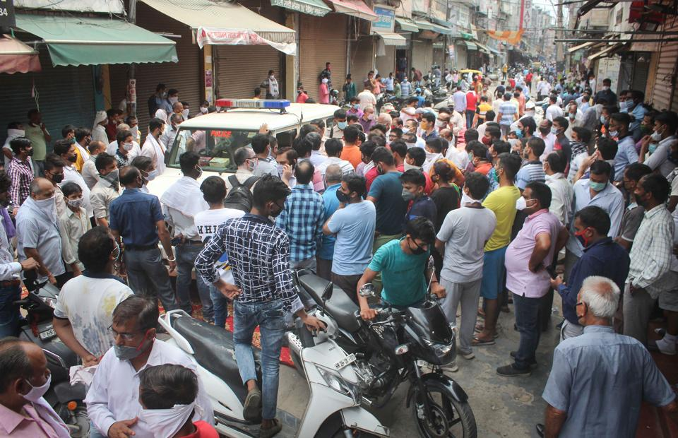 Shop owners during a protest against the Municipal Corporation for allegedly issuing fines and sealing their shops due to land encroachment, at Sadar Bazar in Gurugram on July 16, 2020.
