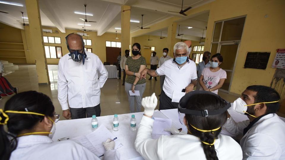 People register at a swab sample collection for coronavirus testing,  Gurugram, Haryana.