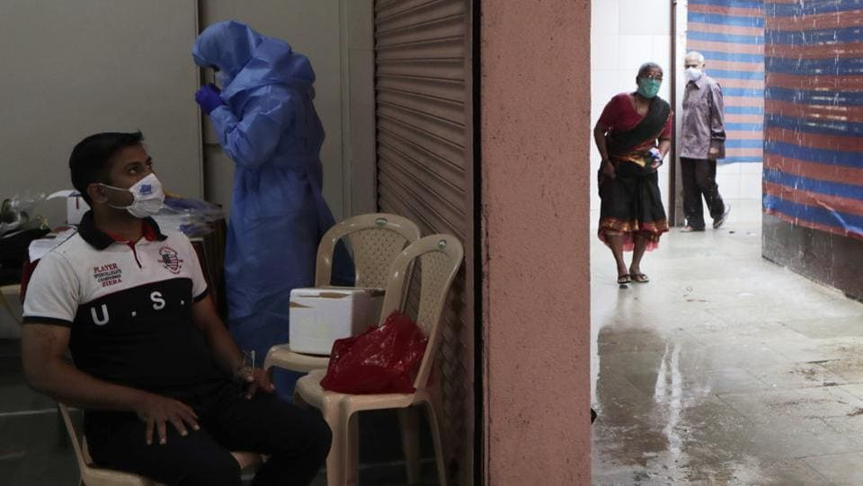 Residents arrive for getting themselves tested for COVID-19 symptoms in Mumbai on July. With the pandemic considered to be plateauing in Mumbai, districts such as Thane, Raigad, Pune and Nanded are now major contributors to the spread of Covid-19 in the state. (Rajanish Kakade / AP)