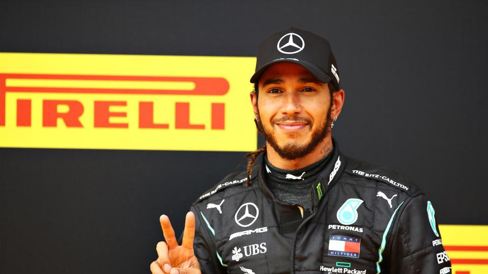 Lewis Hamilton of Great Britain and Mercedes GP celebrates on the podium after winning the Formula One Grand Prix of Styria at Red Bull Ring on July 12, 2020 in Spielberg, Austria. (Photo by Mark Thompson/Getty Images)