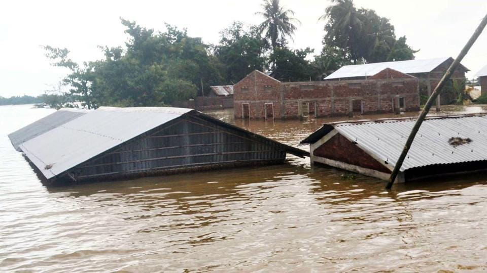 Houses seen submerged in the flood-affected area as the water level of Barpani river rises, in Assam's Nagaon district on Sunday.
