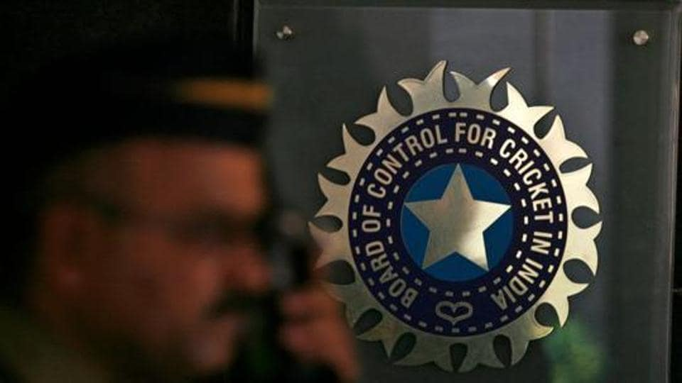 A policeman walks past a logo of the Board of Control for Cricket in India (BCCI) during a governing council meeting of the Indian Premier League (IPL) at BCCI headquarters in Mumbai.