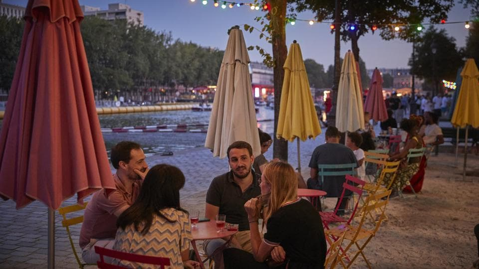 As well as sand and views of central Paris' architecture, Paris Plage offers sporting opportunities such as fencing, giant table-football, and open-air gyms looking out over the Seine, although this year the tighter health restrictions have limited some of the activities. (Kiran Ridley / Getty Images)