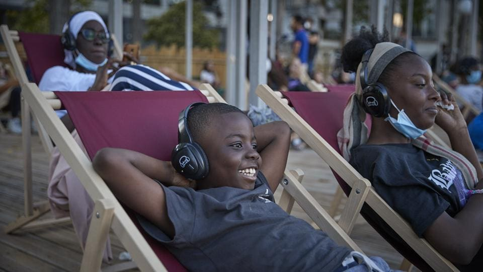"A young boy enjoys the comedy ""Le Grand Bain"", at La Villette on July 18. Cinemas have reopened in France, but occupancy levels remain very low. While the virus has been under control with fatalities and the number of people in intensive care falling, daily cases have increased ahead of the summer holiday season, Reuters reported. (Kiran Ridley / Getty Images)"