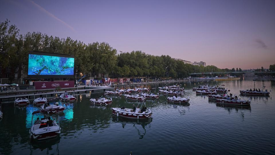 Parisians during a screening at the floating cinema at La Villette, on July 18. Reuters reported that people heading to the opening of Paris Plages were met with Covid-19 testing centres using PCR (polymerase chain reaction) tests with a capacity to carry out 150 to 200 a day. (Kiran Ridley / Getty Images)