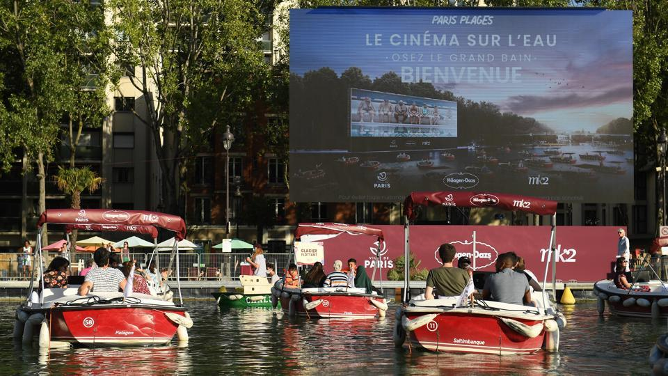 A general view of the Paris Plages during the screening of 'Le Grand Bain' in Paris on July 18. After drive-in cinema, open air floating cinema was quick to gain popularity among Parisians as occupancy in conventional cinema halls continues to be low following the easing of coronavirus lockdowns, Reuters reported. (Pascal Le Segretain / Getty Images)