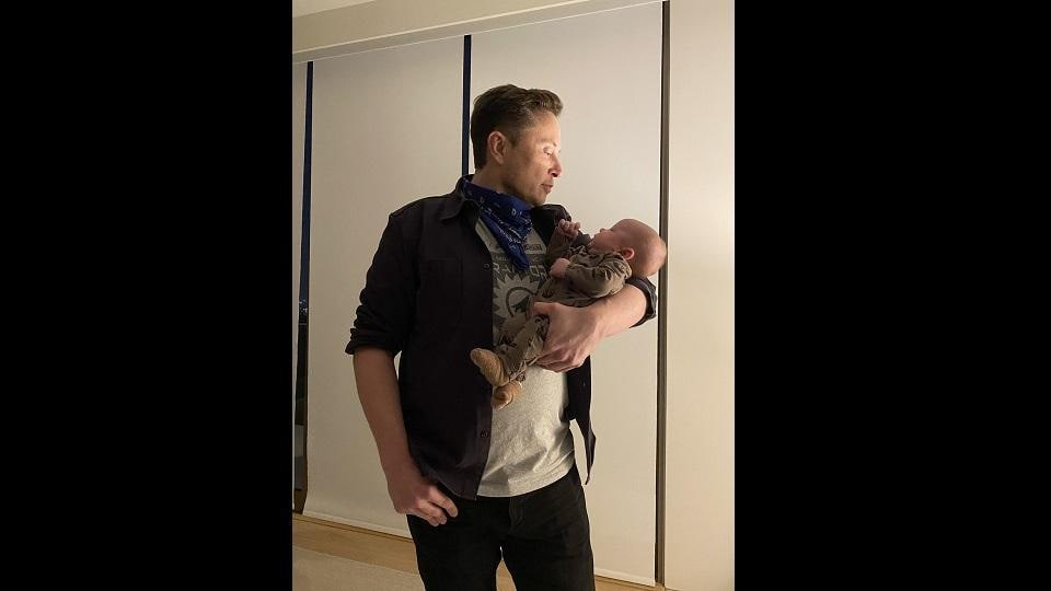 Elon Musk with his son X AE A-XII.