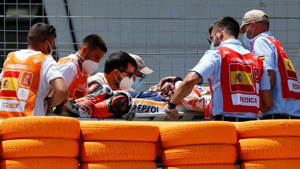 Repsol Honda's Marc Marquez is stretchered into an ambulance after crashing out during the race.