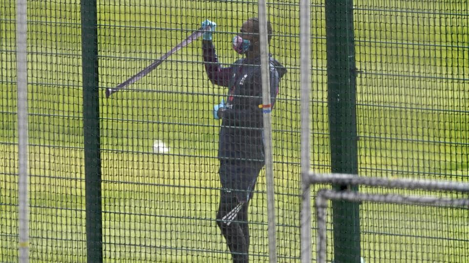 England's Jofra Archer wearing face mask and gloves as a precaution against the coronavirus trains in the nets at Old Trafford in Manchester