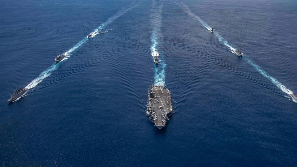 Indian naval ships conduct a Passage Exercise (PASSEX) with the United States Navy's USS Nimitz carrier strike group near the Andaman and Nicobar (A&N) islands as it transits the Indian Ocean.