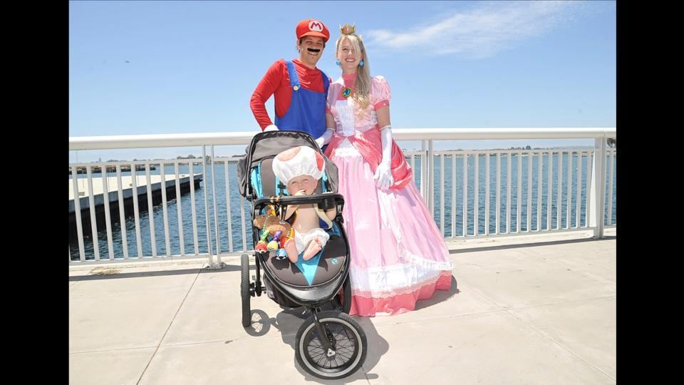 The Divis family dressed as Mario, Princess Peach and Toad from the Mario Bros. franchise, on day one of Comic-Con International in San Diego on July 18, 2019. (Shotwell/Invision/AP)