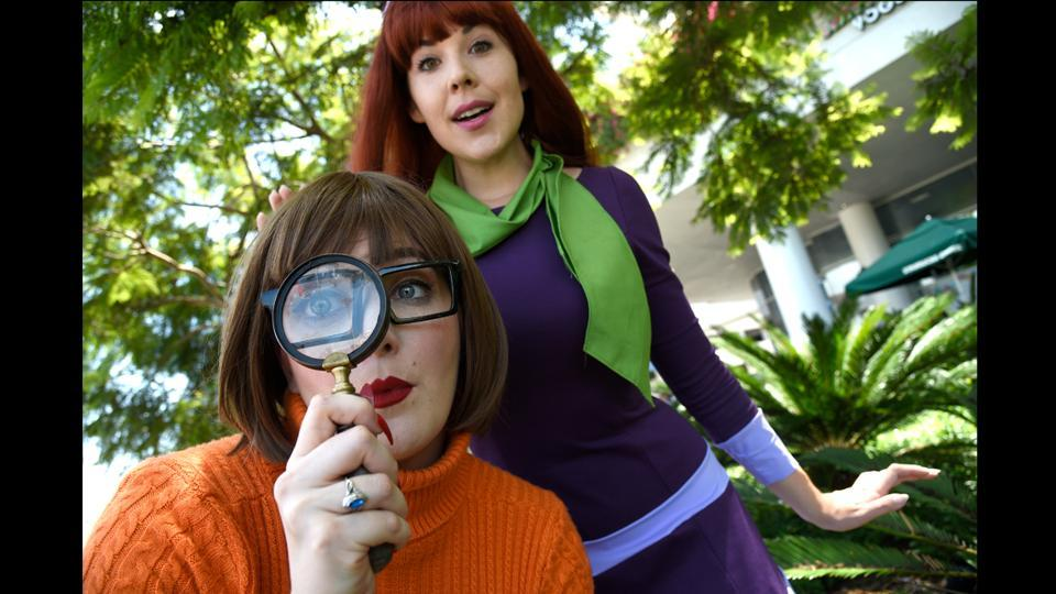 "Melinda Gross (L) and Kit Quinn, dressed as Velma and Daphne from ""Scooby Doo"" on day one of Comic-Con International in San Diego on July 20, 2017. (Chris Pizzello/Invision/AP)"