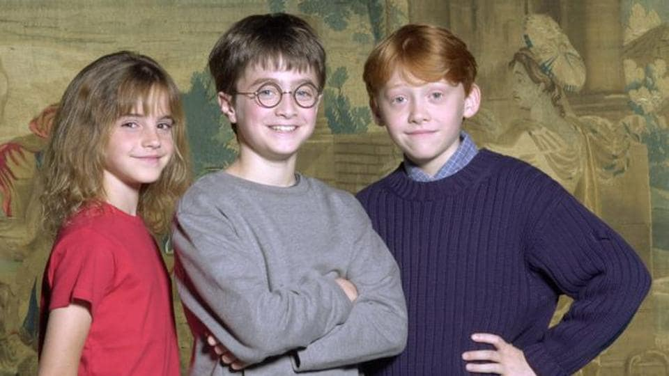 Daniel Radcliffe, Rupert Grint and Emma Watson after being cast as Harry, Ron and Hermione.