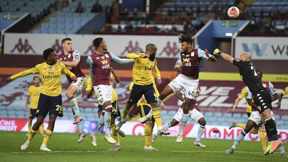 Aston Villa's goalkeeper Pepe Reina, right, punches the ball clear of the goal during the English Premier League soccer match between Aston Villa and Arsenal at Villa Park in Birmingham, England, Tuesday, July 21, 2020. (AP Photo/Shaun Botterill,Pool)