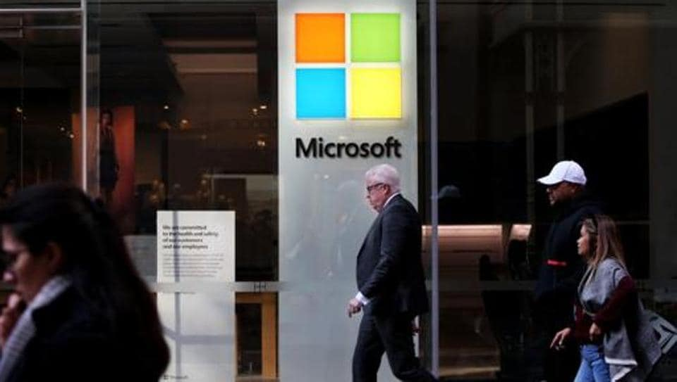 Pedestrians walk past a closed Microsoft Corp. store at Pitt Street Mall in Sydney, Australia.