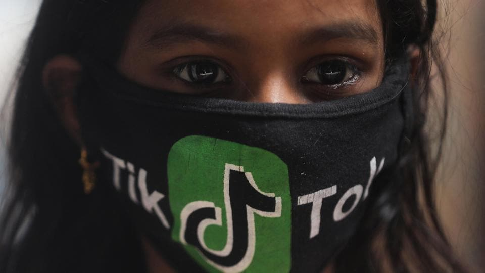A girl wearing a protective mask depicting the TikTok logo poses for a picture inside a slum in Mumbai, India, July 1, 2020. (Representational)