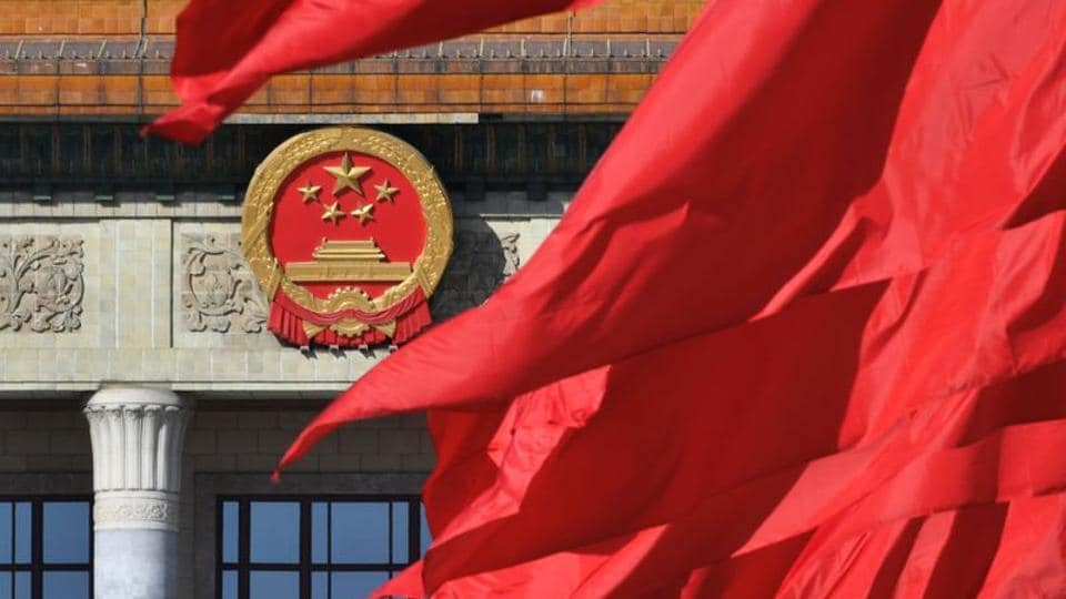 Red flags flutter outside the Great Hall of the People during the closing session of the Chinese People's Political Consultative Conference (CPPCC) in Beijing, China.