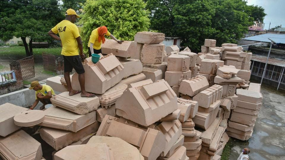 Workers clean stone blocks to be used in construction of the Ram Temple, at a workshop in Ayodhya, on July 21.