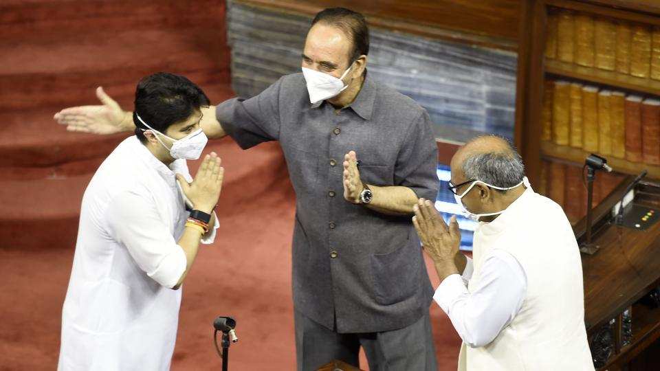 BJP Leader Jyotiraditya Scindia greets Congress leader and local opponent Digvijay Singh in the presence of Congress leader Ghulam Nabi Azad, before taking oath as  a member of Rajya Sabha. (Arvind Yadav / HT Photo)