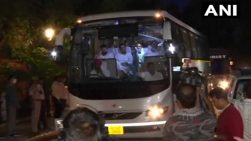 Congress MLAs, supporting CM Ashok Gehlot, leave from Raj Bhawan where they had been protesting over the issue of the convening of an assembly session.