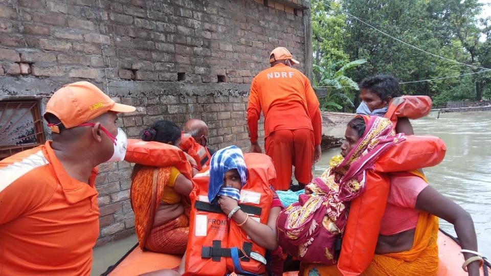 NDRF personnel rescuing people in Bihar's East Champaran district on Friday after the Gandak river breached an embankment.