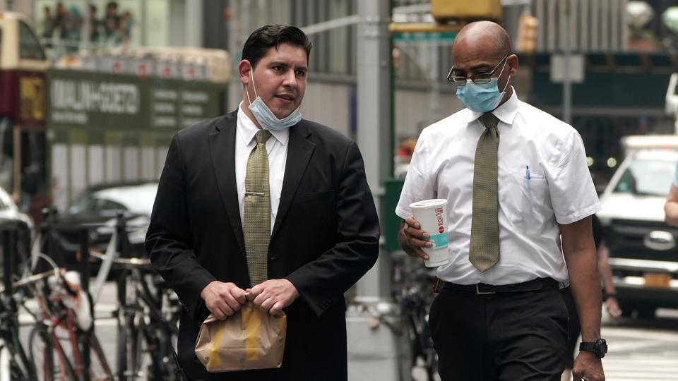 Men dressed in business attire walk on 6th Ave. following the outbreak of coronavirus disease (Covid-19) in the Manhattan borough of New York City, New York, US on July 23, 2020.