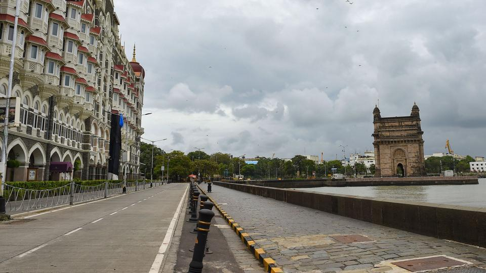 A deserted road leads up to the Gateway of India, in Mumbai on July 23. Maharashtra continues to grapple with the spread of Sars-Cov-2, four months after having entered a state of lockdown and then attempting gradual relaxations in attempts towards normalcy since June. The state remains the country's worst affected region in terms of Covid-19 as of July 23. (Kunal Patil / PTI)