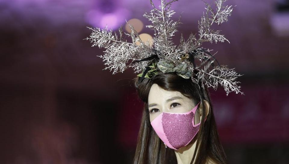 A model wearing a face mask poses during a mask fashion show amid the coronavirus pandemic in Seoul, South Korea, Friday, July 24, 2020. (AP)