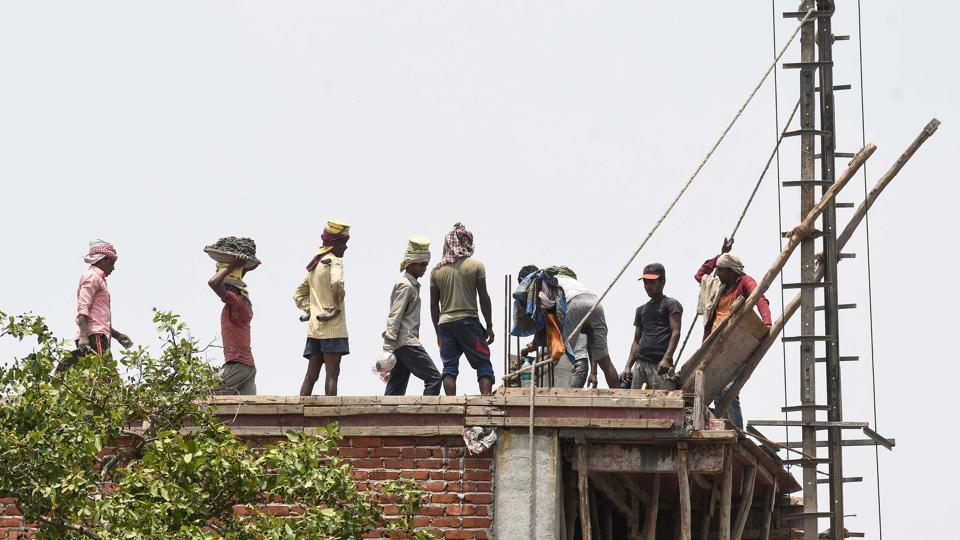 Construction workers at a building site near Dishad Garden in New Delhi.