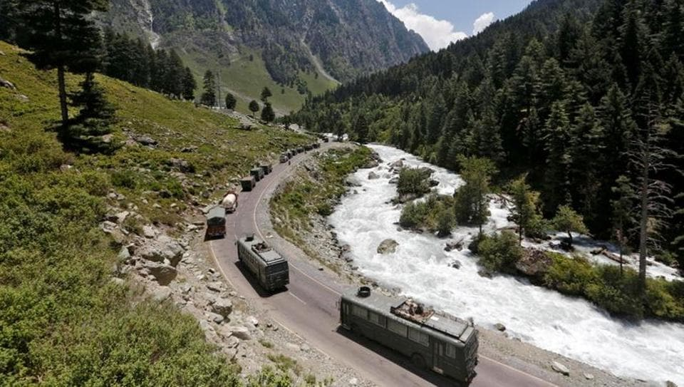 An Indian Army convoy moves along a highway leading to Ladakh, at Gagangeer in Kashmir's Ganderbal district.