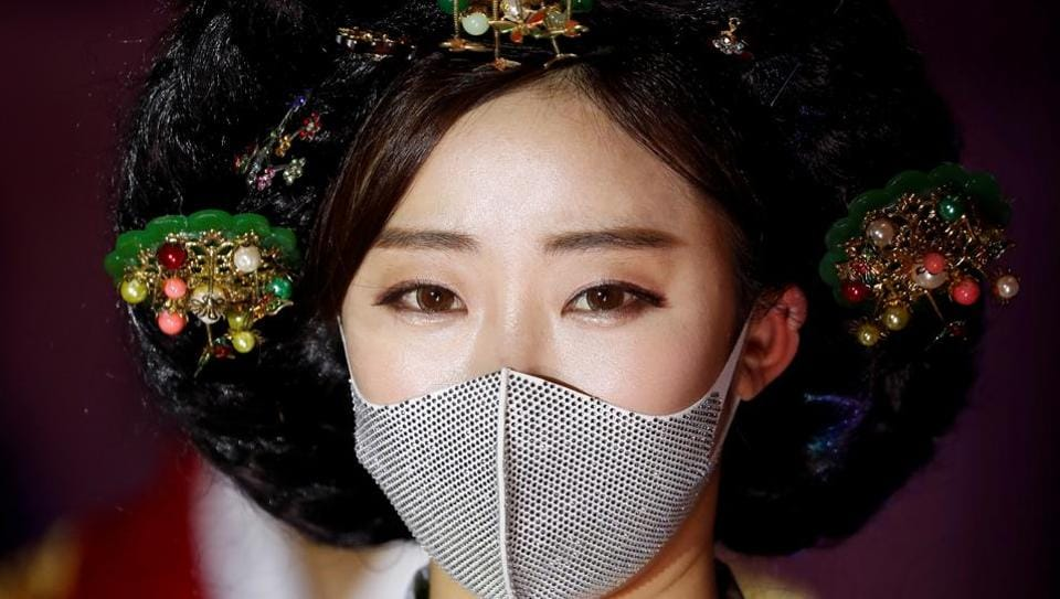 A model wears a mask during a fashion show as a measure to avoid the spread of the coronavirus disease (COVID-19), in Seoul, South Korea July 24, 2020.