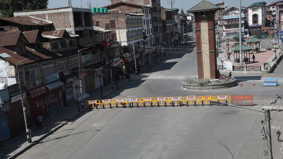 A view of the Lal Chowk clock tower and marketplace deserted during lockdown in Srinagar, Jammu and Kashmir.