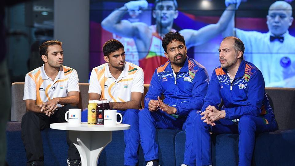 (L-R) Boxer Amit Panghal, boxer Manish Kaushik, coach CS Kutappa and coach Santiago Nieva during an interview with Hindustan Times, at HT House, in New Delhi.