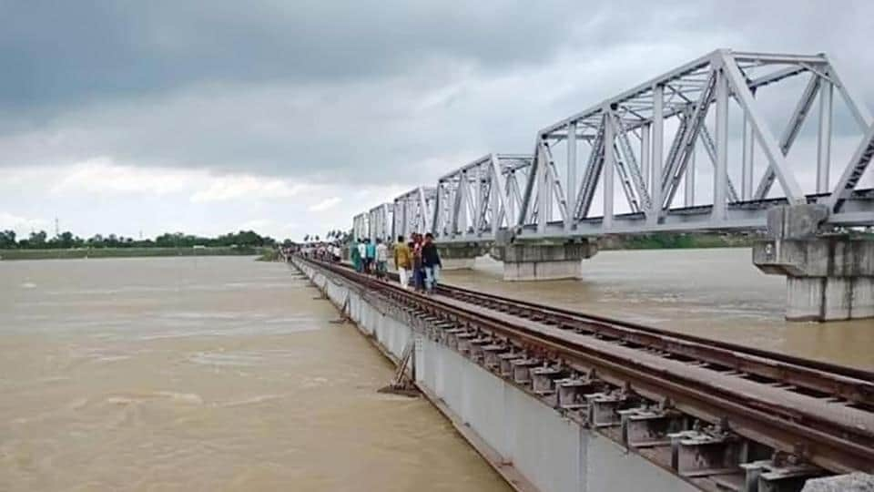 Floodwaters have entered homes in Bishunpur village of Darbhanga district, forcing people to wade through waist-deep water, even as they try and salvage their valuables.