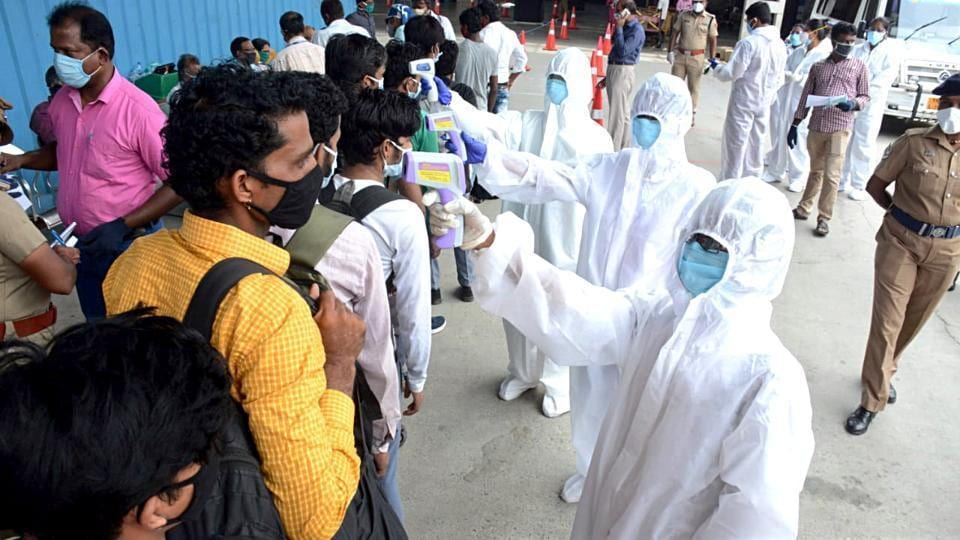 File photo of medical personnel checking the temperature of passengers  at a railway station in Madhya Pradesh