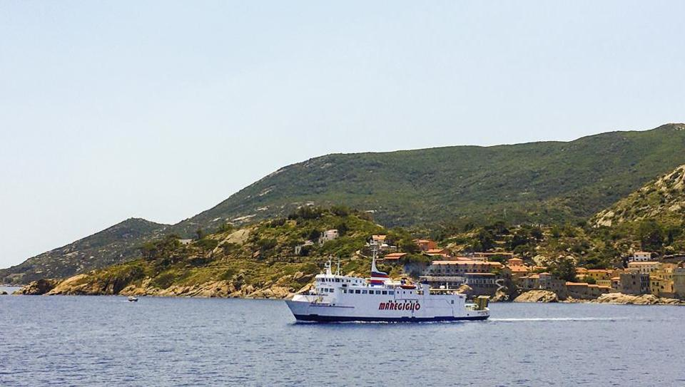 A ferry leaves Giglio island, near the Italian coast of Tuscany, Tuesday, June 23, 2020. In spite of various people with coronavirus stopped by the island at times, no one of the islanders developed COVID-19 infection. For Paola Muti, a professor of Epidemiology, being trapped by lockdown in her late mother's house for months on Giglio Island, the situation also made for an opportunity to possibly contribute to scientific understanding of why some people in close contact with people ill with Covid-19 don't get infected. (AP Photo/Paolo Santalucia)
