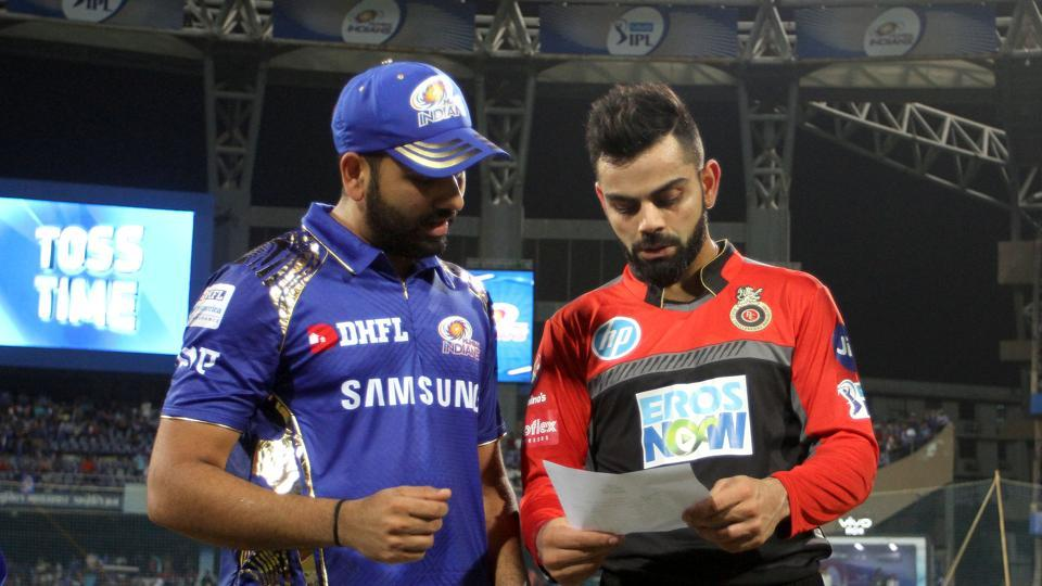 Rohit Sharma captain of the Mumbai Indians and Virat Kohli captain of the Royal Challengers Bangalore during the toss of the match fourteen of the Vivo Indian Premier League 2018 (IPL 2018) between the Mumbai Indians and the Royal Challengers Bangalore held at the Wankhede Stadium in Mumbai on the 17th April 2018. Photo by: