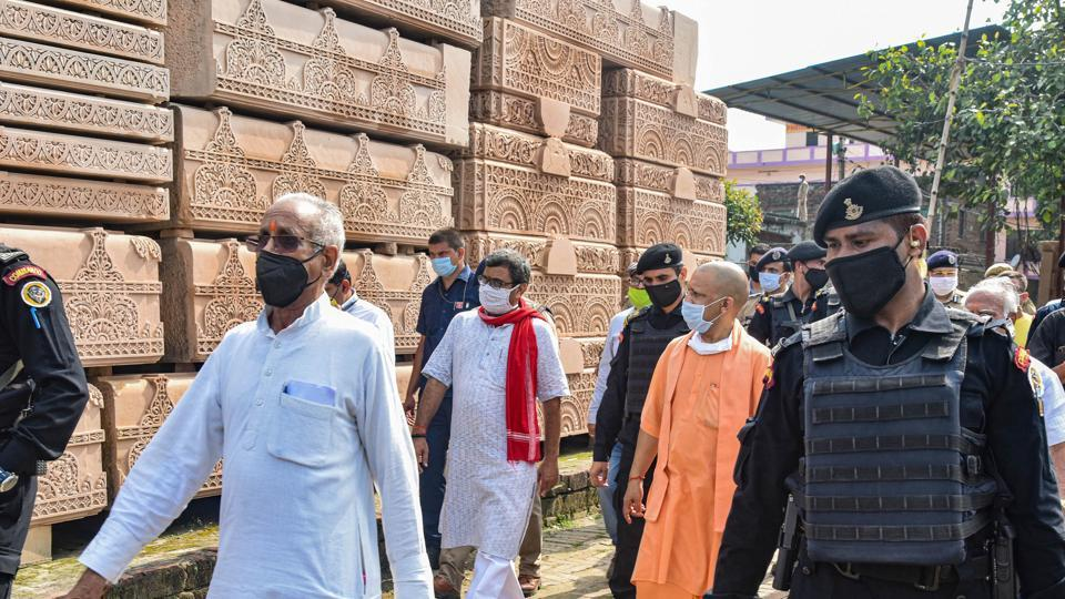 Uttar Pradesh Chief Minister Yogi Adityanath with Ram Janmabhoomi Tirth Kshetra Trust General Secretary Champat Rai (front -L) visits the Ram Temple construction workshop, in Ayodhya.