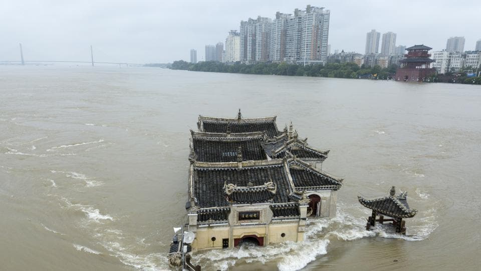 The Kwanyin temple built on a rocky island in the middle of the Yangtze River is seen flooded as the water level surge along Ezhou in central China's Hubei province on Sunday, July 19, 2020.