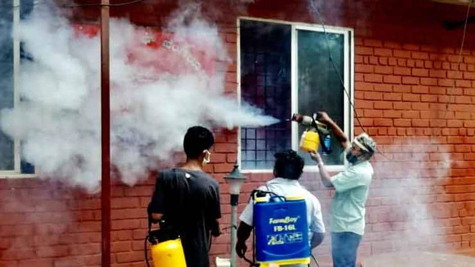 Civic workers spraying disinfectant  in a locality in Bengaluru