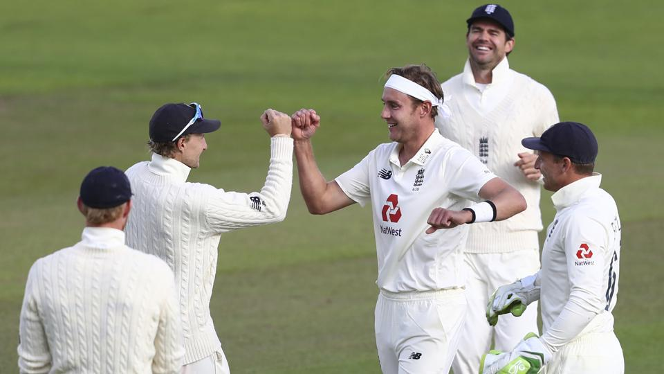 England's Stuart Broad, center, celebrates with teammates the dismissal of West Indies' John Campbell. (AP)